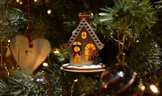 Christmas ornament house on tree